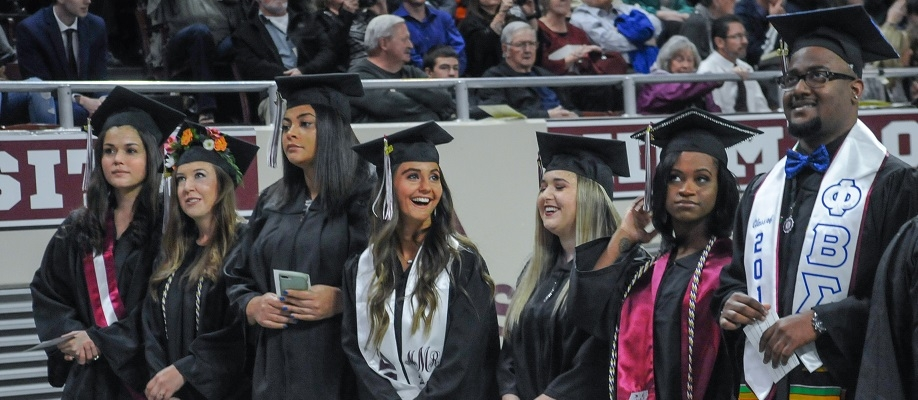 EKU graduates stand as they await to receive their diplomas